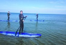 Paddleboarders in action – now, imagine crossing all the way over to Holyhead like this ...