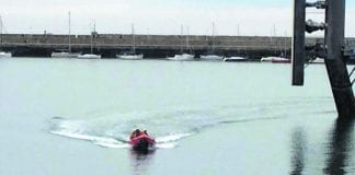 The jetskier in Dun Laoghaire being rescued by the Coast Guard.