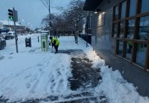 Dublin City Council staff working to clear pathways following snow overnight
