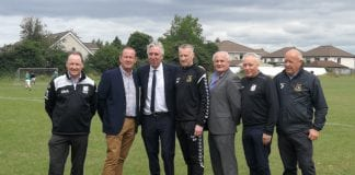 FAI Chief Executive John Delaney (pictured with Executive Committee members of Knocklyon United and Mick Kennedy of the DDSL) has pledged the FAI's support to the club's campaign to keep their pitches in Ballycullen Park