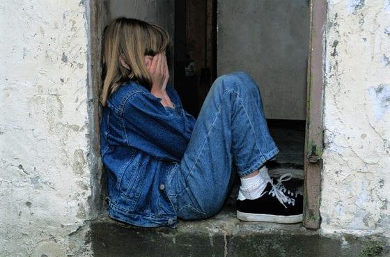 Child upset in a doorway.