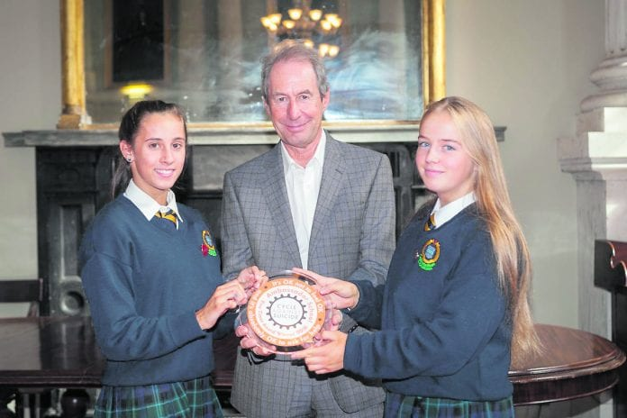 Dr Harry Barry with Colaiste Bride students Morena Bramley and Kiara O'Keefe