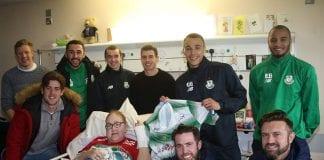 Shamrock Rovers FC team members with Chloe in hospital