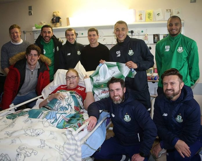 Shamrock Rovers FC team members with Chloe in hospital