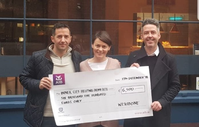 David Clarke, Michelle Hetherington and James Stimpson with the cheque for €6,500 to present to help the homeless