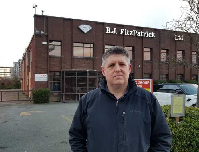 Brian Leeson at the front of the Grafton House, Ballymoss Road, Sandyford Industrial Estate building